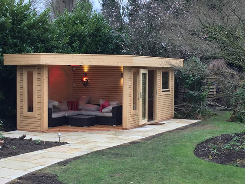 Garden office with covered seating area garden office guide for Garden designs seating areas