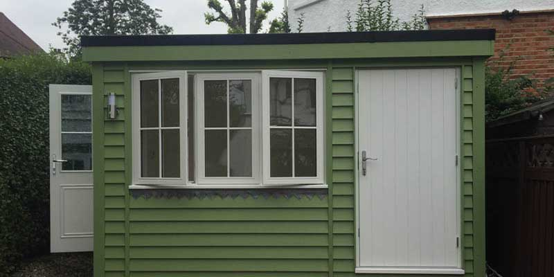 Painted garden office with shed